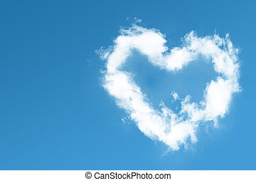 Fluffy heart cloud on blue sky