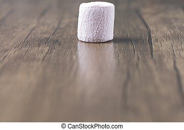 Fluffy marshmallows on a wooden table