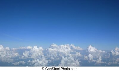 Fluffy Popcorn Clouds from Airline Passenger Perspective -...