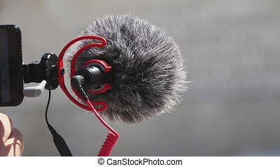 Fluffy professional microphone stuck to the camera and ...