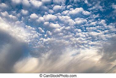 fluffy white clouds landscape