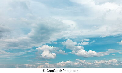 Fluffy White Clouds on Blue Sky