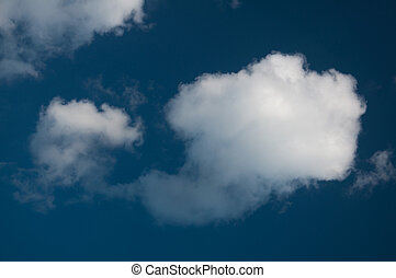 fluffy white clouds with blue sky