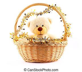white teddy bear in a basket
