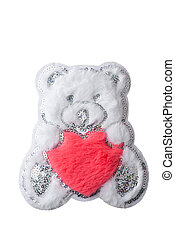 Fluffy white Teddy bear with red heart patch isolated on white background