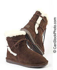 Fluffy woolly warm boots over white background