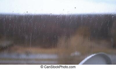 flujo, lluvia, abajo, vidrio, exterior, ventana., gotas de ...