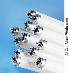 New fluorescent light tubes on blue background.