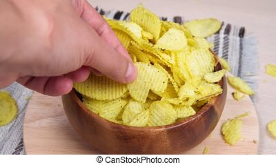 Potato fluted chips with spices, natural product close-up. Fast food.