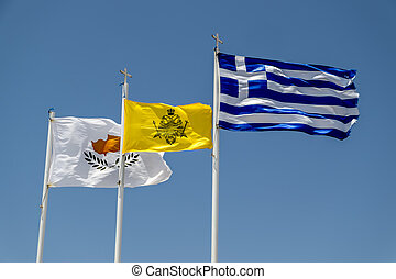 Fluttering in the wind flags of Cyprus and Greece against the sky