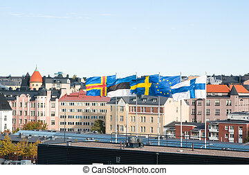 Fluttering Scandinavian flags against the sky