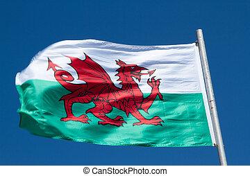 Fluttering Welsh flag.