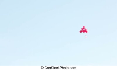 Fly away balls - Bunch of red balloons flying away on blue...