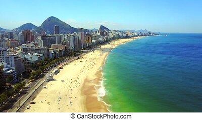 Fly down to Ipanema Copacabana Beach in Rio de Janeiro...