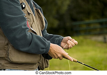 fly fisher - Angler, focus on body and rod