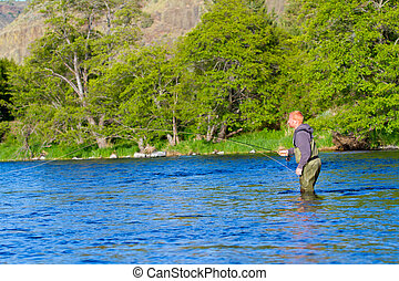 Fly Fisherman Deschutes River - An experienced fly fisherman...