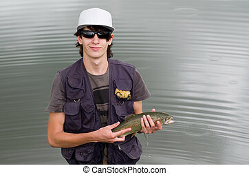Fly fisherman with rainbow trout