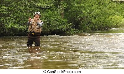fly fishing a trout stream - trout fishing on a running...