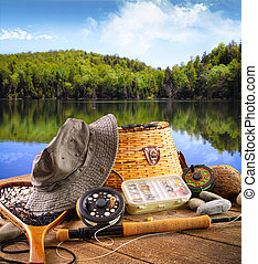Fly fishing equipment near a lake - Fly fishing equipment on...