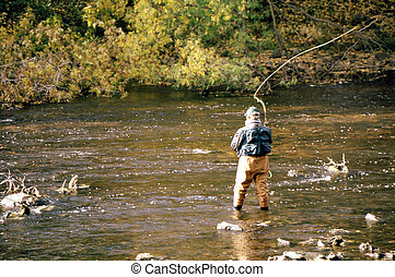 Fly Fishing FF-1009 - Man fly fishing in a slow moving ...