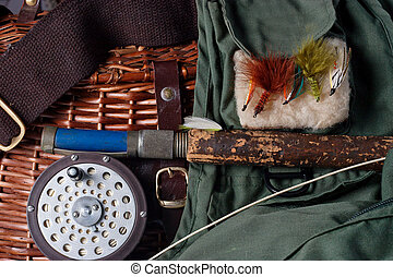 Fly fishing stilife with rel, pole creel and vest