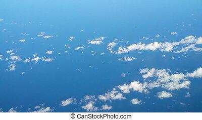 fly high over cloudsand ocean