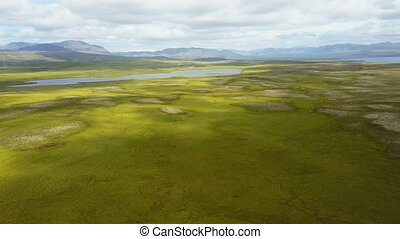 Fly over beautiful lush summer landscape at Iceland - Camera...