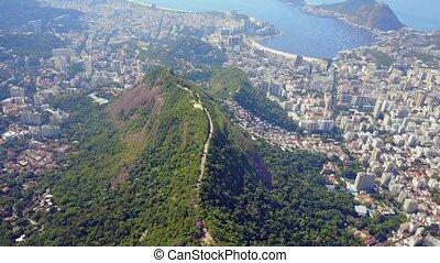 Fly over Mountains and Central Downtown Rio de Janeiro...