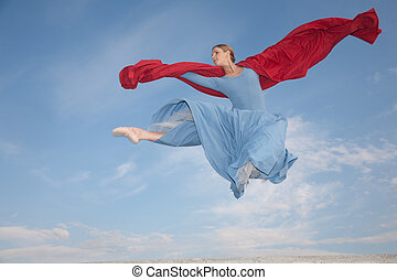 fluing proffesional ballerina jumping over blue sky