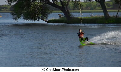 Fly Rider - Tracking shot of cool wakeboard rider doing...