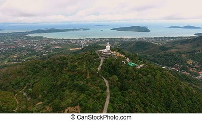 Fly to big statue of Buddha in Phuket, Thailand....