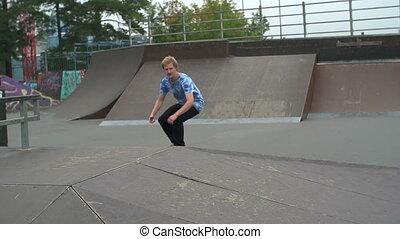 Fly Trick - Slow motion of skateboarder in skatepark...