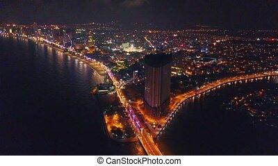 Flycam Shows Night Skyscraper at Ocean Bay Bridge