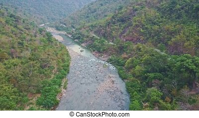 Flycam View Rocky River near Road between Tropical Plants