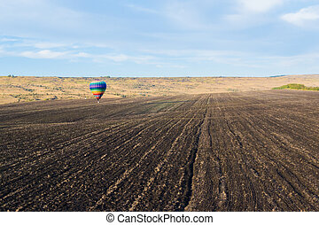 a balloon flying above the ground