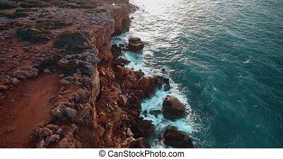 fliying above beautiful sea shore during sunset