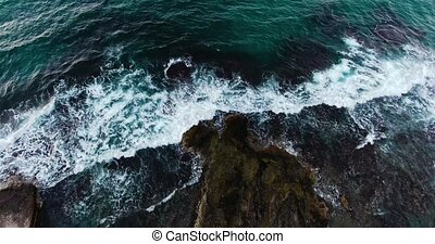 flying above beautiful wavy seashore at evenng