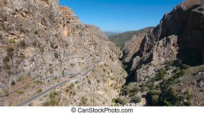 deep gorge in mountains at crete - flying above deep gorge...