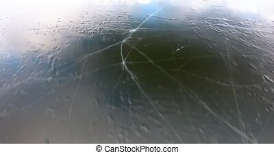 flying above frozen lake with cracked ice