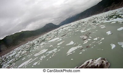 Flying above glaciers in Alaska - Aerial from plane