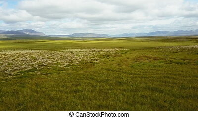 Flying above lush summer landscape at Iceland - Camera...
