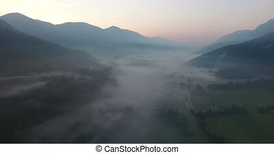 Flying above mist covered valley.