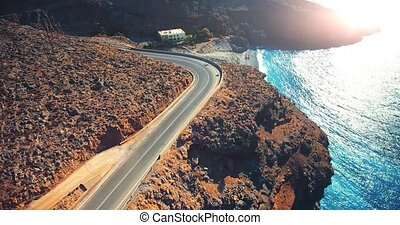 flying above road by seashore