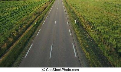 flying above road in fields