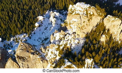 Flying above rocky mountain. Lady's Stones in Rarau ...