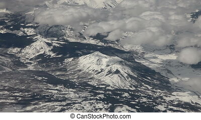 Flying  above snowy mountains