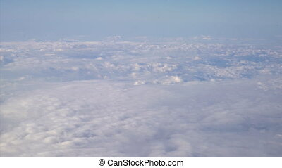 Flying above the clouds. Sunny view from the airplane, soft...