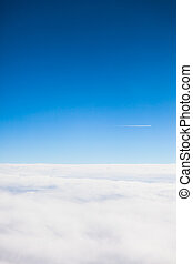 Flying above the clouds view  from a airplane porthole