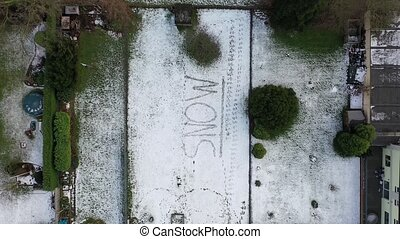 Flying above the word snow written in snow.