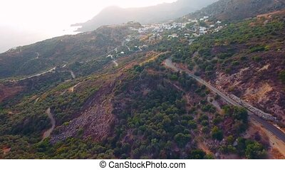 flying above village in mountains at Crete island